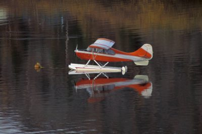 Photo: A float plane parked on a lake at Yellowknife, NWT, Yukon.