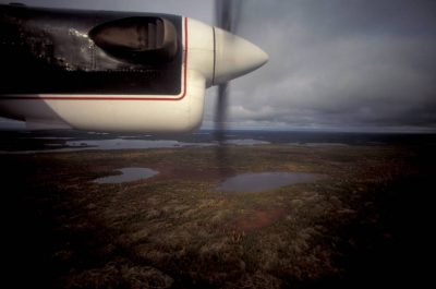 Photo: View from the window of a float plane over diamond mining territory north of Yellowknife, NWT, Canada.