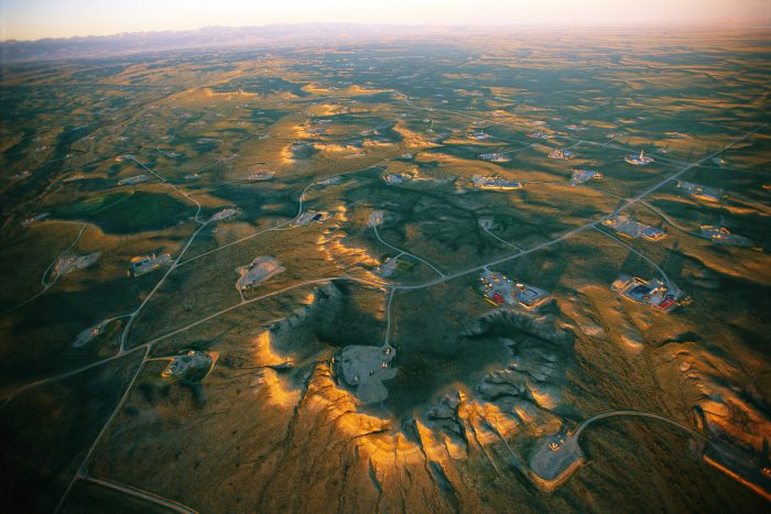 Photo: Aerial of the Jonah Field natural gas drilling area near Pinedale, Wyoming.