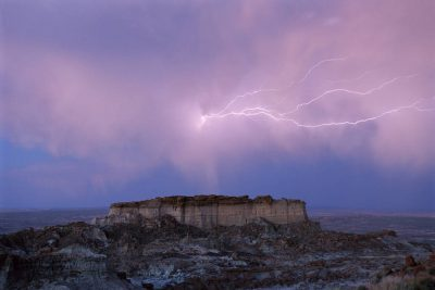 Photo: Lightning illuminates the sky over Adobe Town in Wyoming's Red Desert area.