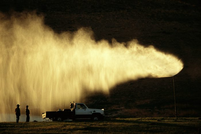 Photo: Misters send the water drained off during coal bed methane drilling airborne on a development near Gillette, WY.
