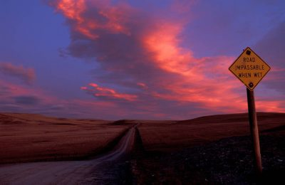 Photo: A road sign at sunset in Choteau, Montana.