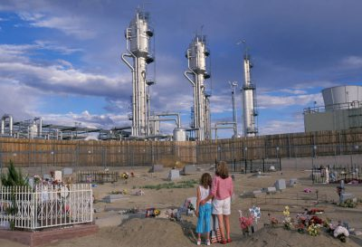 Photo: The sun sets over a cemetary near a gas refinery near Bloomfield, NM in the San Juan Basin.