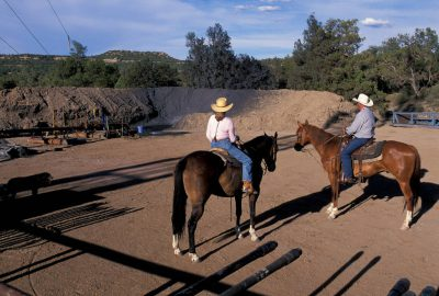Photo: Ranchers at Blancett Ranch move cattle around well pads created for coal bed mining activity.
