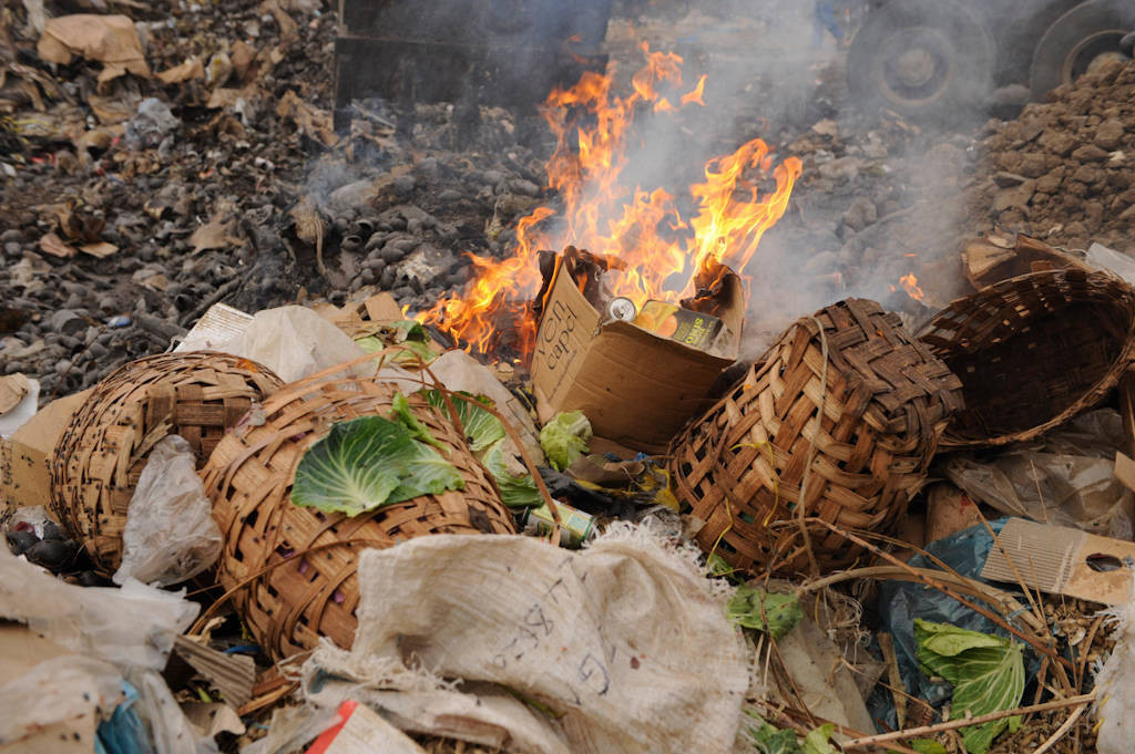 Burning trash in a market in Malabo, Equatorial Guinea, Africa.