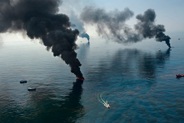 Photo: Boats burn off surface oil not far from the Deepwater Horizon spill site, creating huge black columns of smoke in the Gulf of Mexico.