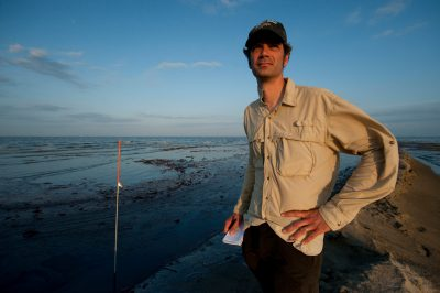 Photo: National Geographic writer, Bruce Barcott, standing on the shoreline of East Grande Terre, Louisiana.