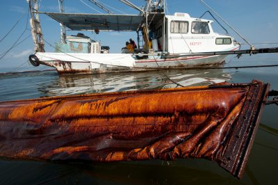 Photo: A former shrimping boat now trawls for oil from the Deepwater Horizon spill in Barataria Bay, Louisiana.