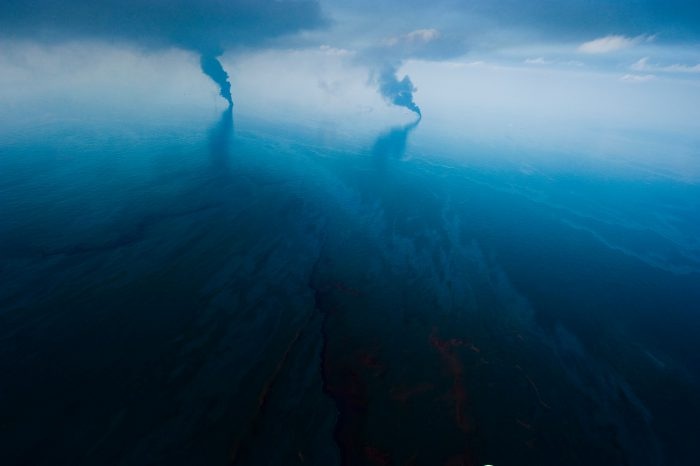Photo: Burning surface oil not far from the Deepwater Horizon spill site creates huge black columns of smoke in the Gulf of Mexico.