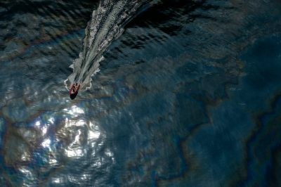 Photo: An aerial of an watercraft cutting through the surface oil near the deep water horizon spill site in the Gulf of Mexico.