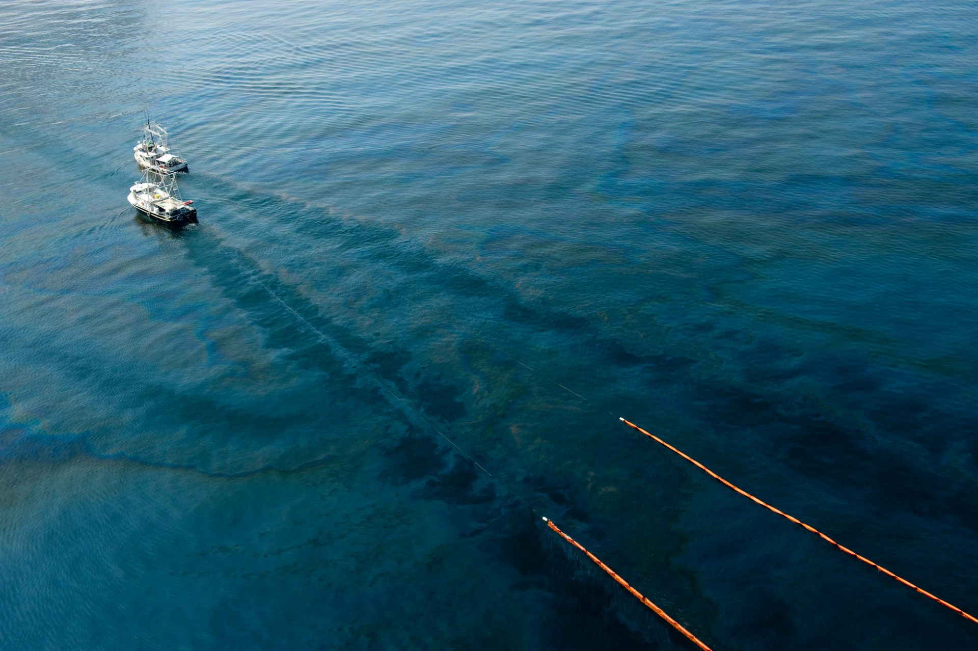 Photo: An aerial of watercraft cutting through the surface oil near the deep water horizon spill site in the Gulf of Mexico.