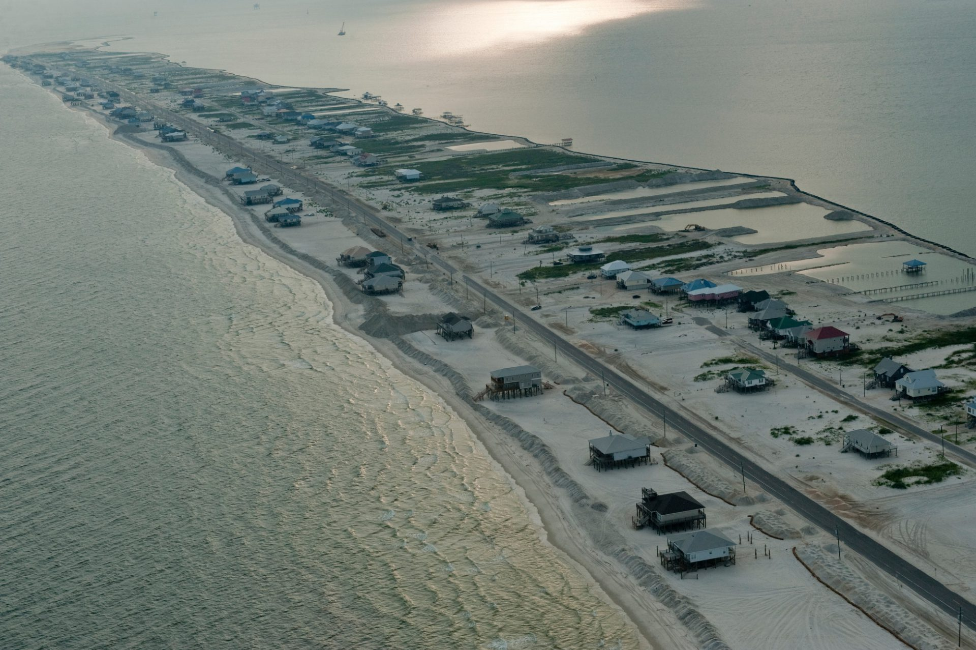 Photo: Sand berms frame rows of beach houses on Dauphin Island, Alabama during the deep water horizon oil spill.