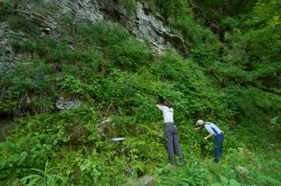 Two women look for the federally endangered Iowa Pleistocene Snails, Discus macclintocki.