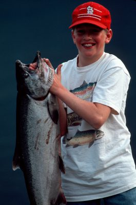 Photo: A lucky young fisherman on the Wind River (trib. of the Columbia R.) holds up a Spring Chinook Salmon.