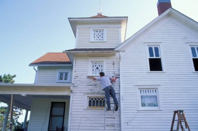 Photo: Joel Sartore stretches out to reach the tough spots as he restores his late 19th-century historic farm house (Waveland Farm) near Walton, Nebraska.