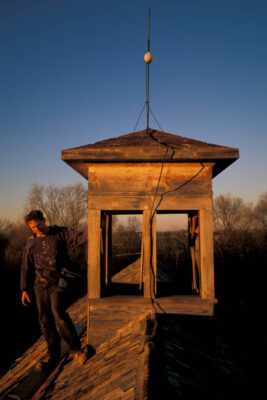 Photo: Joel Sartore stands next to the cupola atop the barn at historic Waveland farm (farmstead ca. 1890).