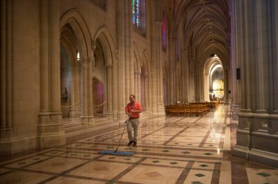 Photo: A man sweeps the floor of the Washington National Cathedral in Washington, D.C.