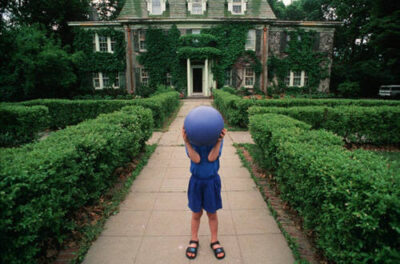 Photo: Cole Sartore stands outside of his historic Lincoln home prior to its restoration.