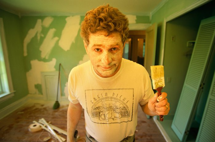 Photo: Joel Sartore, covered in paint, after a day of work restoring his historic home in Lincoln, Nebraska.