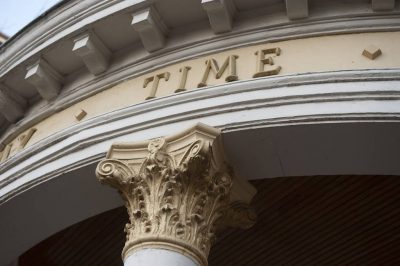 "Photo: ""Time"" inscribed onto the exterior of a building in Denver, Colorado."