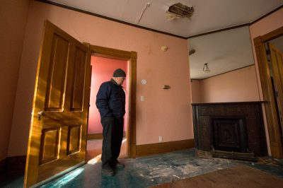 Photo: An elderly man walks through the fourth oldest home in Lincoln, Nebraska.