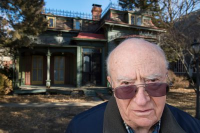 Photo: An elderly man stands outside the fourth oldest home in Lincoln, Nebraska.