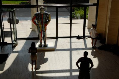 Photo: Students from an college English class observe a sculpture at the Sheldon Memorial Art Gallery.