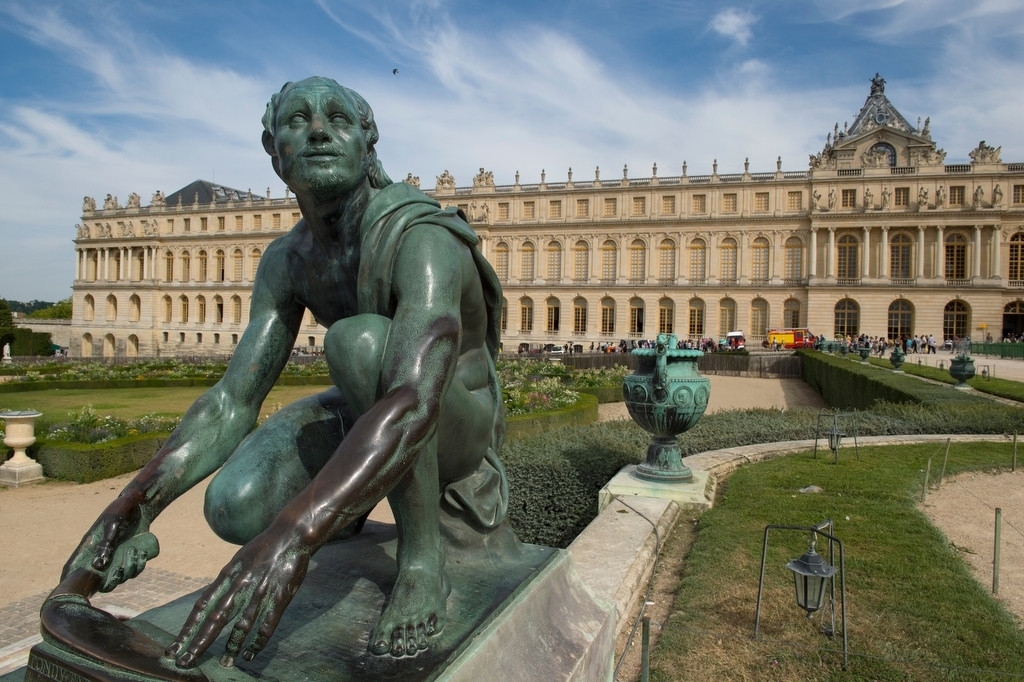 Photo: A sculpture in a garden outside the Palace of Versailles.
