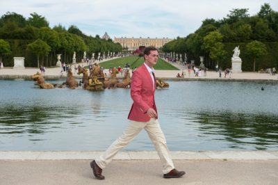 Photo: A young man walks in Versailles, France.