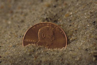 Photo: A penny in the sand.