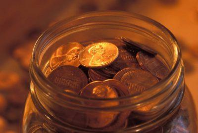 Photo: A jar full of copper pennies.
