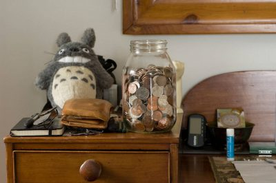 Photo: A jar full of coins.