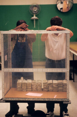 Photo: Two men look at one million dollars through a glass case at the Federal Reserve in Boston.
