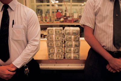 Photo: Two supervisors at the Federal Reserve in Boston guard two stacks of $100 bills, totaling in one million dollars and 22 pounds.