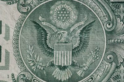 Photo: A close-up of a one-dollar bill.