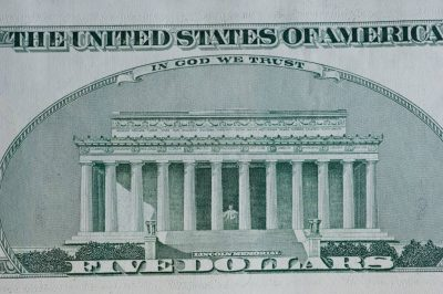 Photo: A close-up of a five-dollar bill.