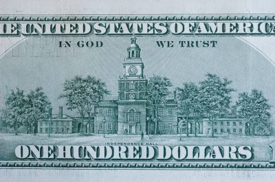 Photo: A close-up of a one hundred-dollar bill.