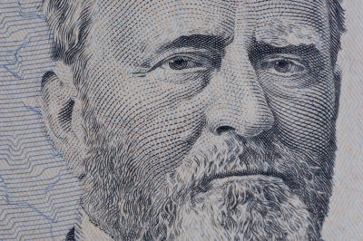 Photo: A close-up of a fifty-dollar bill.