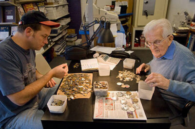 Photo: Two men count out change at The Coinery in Lincoln, NE.