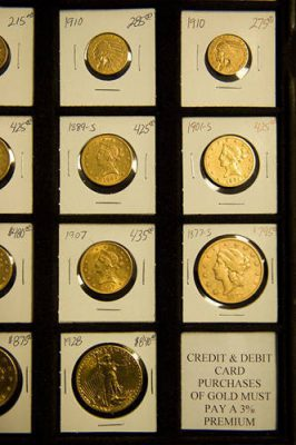 Photo: A display of vintage gold U.S. currency for sale at The Coinery in Lincoln, NE.