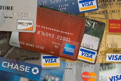 Photo: A close-up of numerous credit cards.