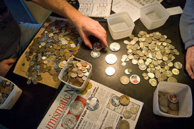 Photo: A man counts out change at The Coinery in Lincoln, NE.