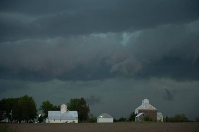 Photo: Storm clouds build over a rural home.