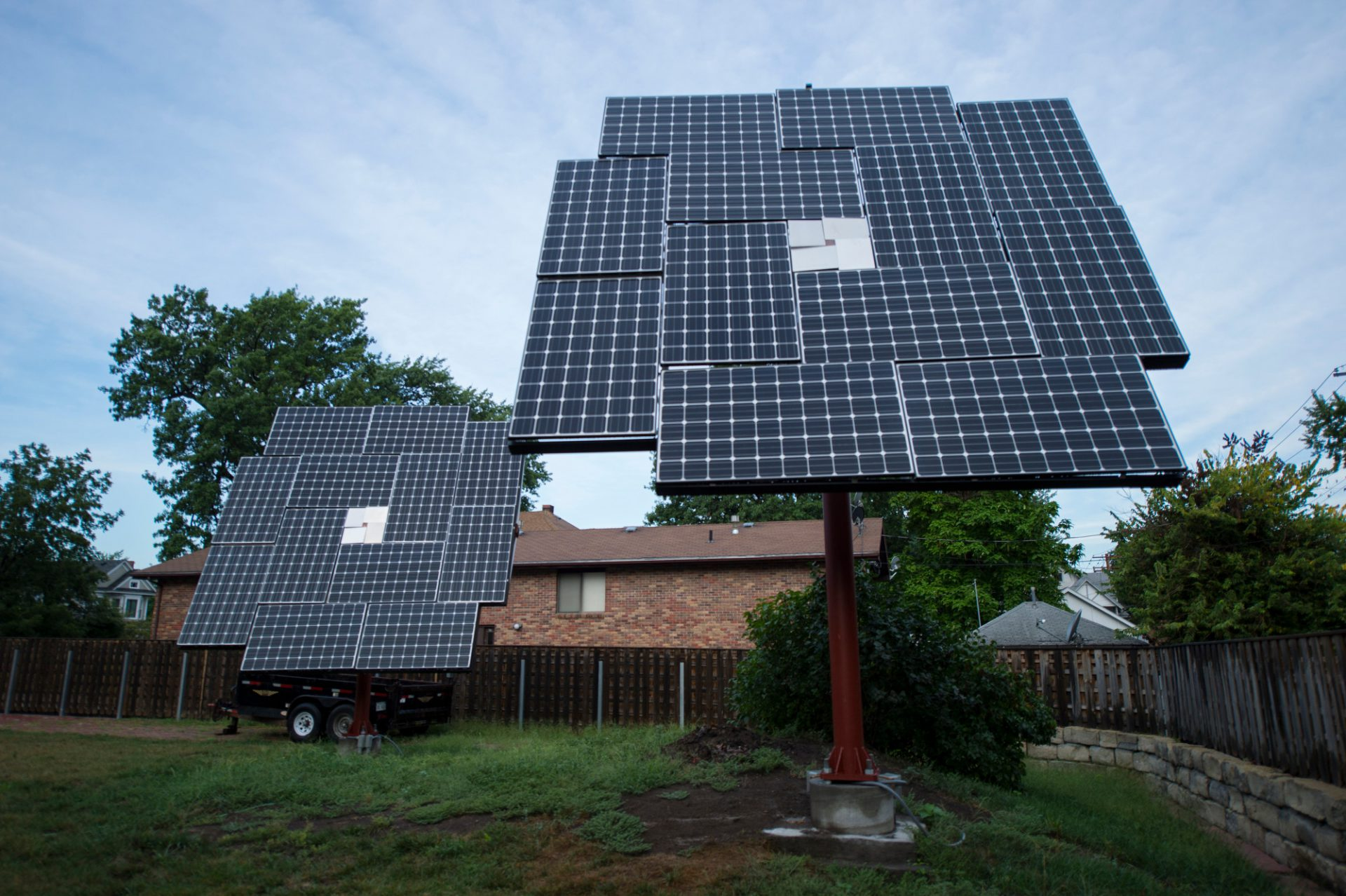Photo: Solar panels in a backyard.