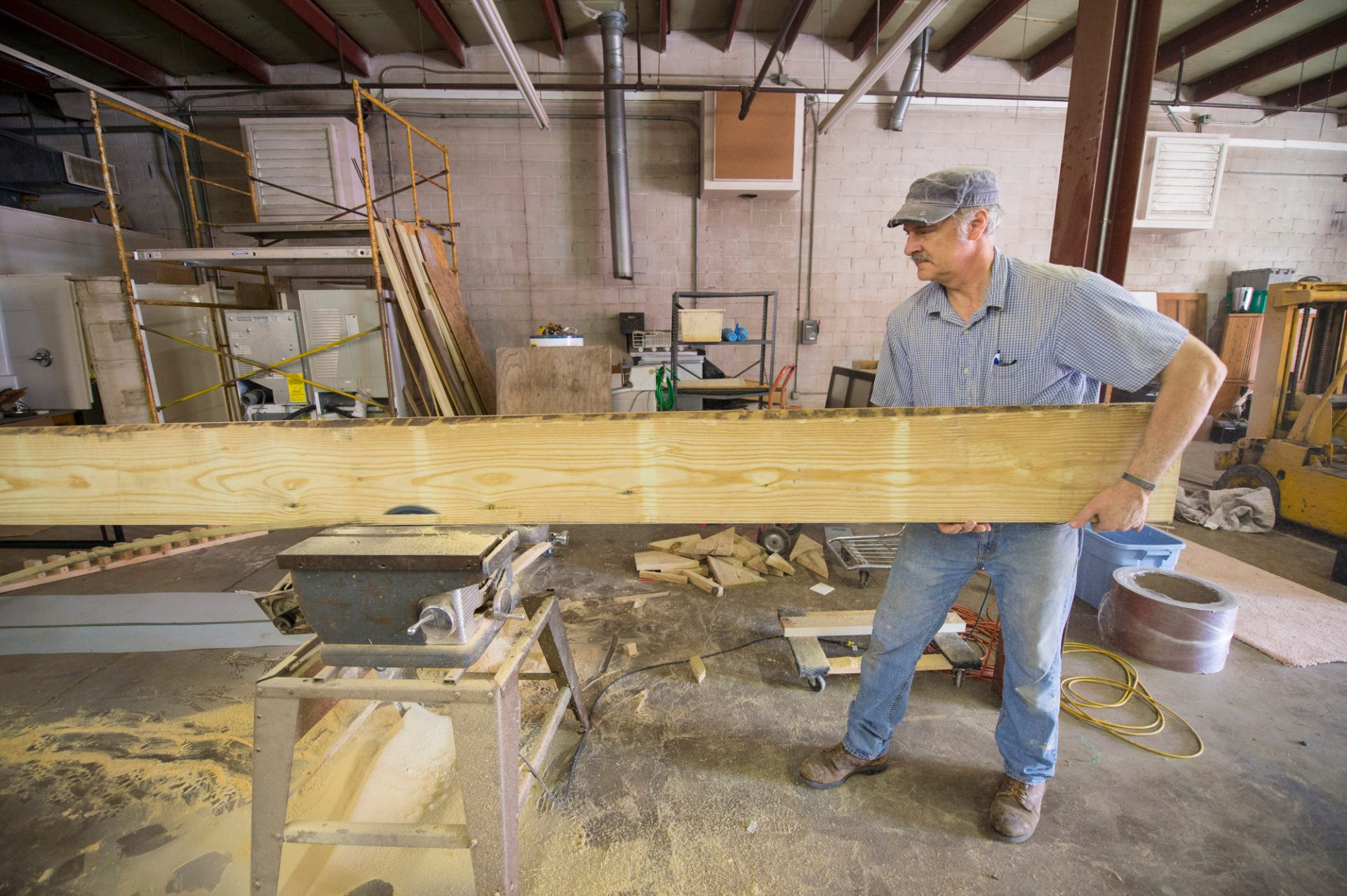 Photo: A man works in his wood shop.