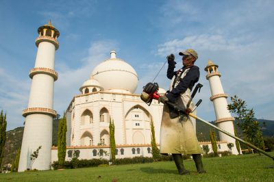 Photo: A staff member fires up a lawn trimmer on the grounds of the replica of the Taj Mahal at Parque Jaime Duque in Columbia.