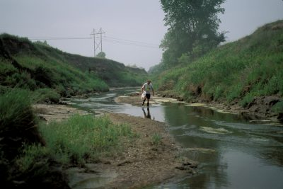 Photo: Entomologist Steve Spomer walks down the bank of Salt Creekin northern Lancaster County, Nebraska, looking for the Salt Creek tiger beetle.
