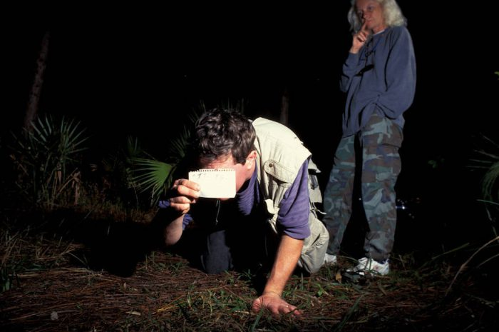 """Photo: Photographer Joel Sartore tests a """"camera trap"""" designed to photograph an endangered Florida panther in the wild."""