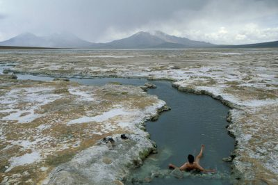 Photo: Sergio Ballivian, an assistant/fixer on the Atacama Desert shoot, soaks in a salt springs.