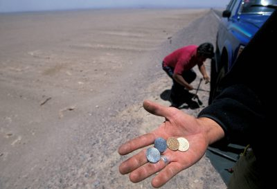 Photo: Sergio Ballivian, an assistant/fixer on the Atacama Desert shoot, changes a tire on a road in the middle of nowhere.
